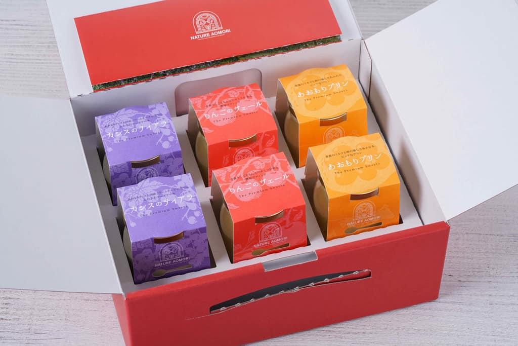 真っ赤な化粧箱に入ったナチュール青森のスイーツ「カシスのティアラ2個・りんごのヴェール2個・あおもりプリン2個」、お取り寄せスイーツ、通販プリン