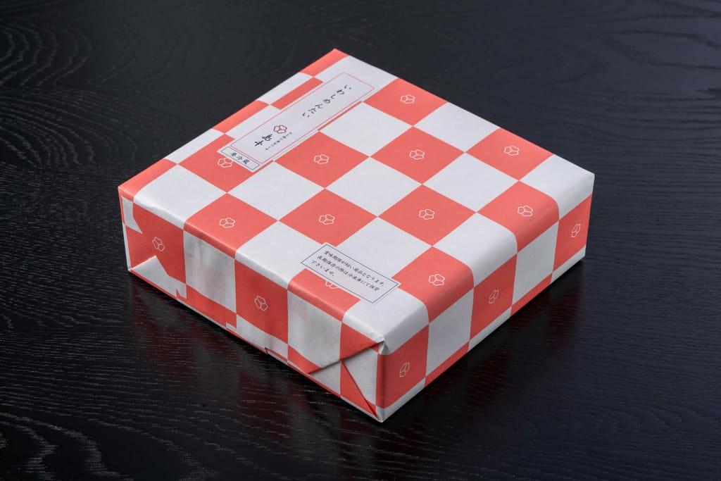 島本食品の博多名物いわしめんたい(4尾入)のパッケージ